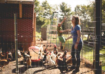 Emily feeding her chickens