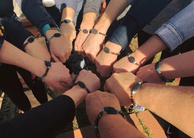 Circle of fists with matching bracelets